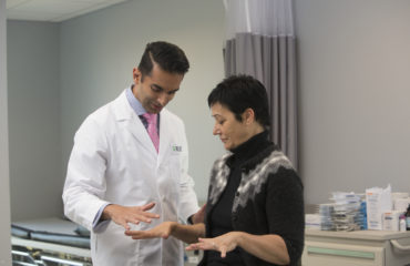 dr kern singh examines patient